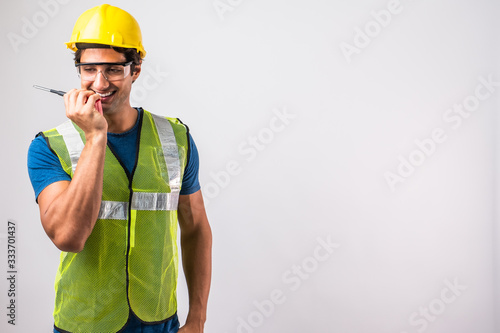 Factory engineers brazil wear yellow uniforms, Put safety equipment wear yellow hats and use radio to communicate assign signal communicate Lifting iron in Construction site the factory Canvas Print