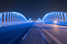 Meydan Bridge And Street Road Or Path Way On Highway With Modern Architecture Buildings In Dubai Downtown At Night, Urban City At Night, United Arab Emirates Or UAE.