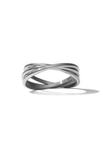 Close-up Shot Of A Silver Triple Rolling Ring Symbolizing Friendship, Loyalty And Love. The Symbolic Ring Is Isolated On The White Background.