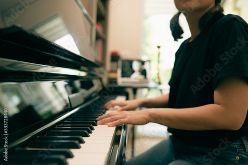 Stampa su Tela Scene of piano lessons online training or E-class learning while Coronavirus spread out or covid-19 crisis situation, vlog or teacher make online piano lesson to teach students pupils learn from home