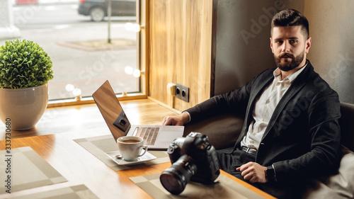 Caucasian adult bearded man indoors in cafe Tapéta, Fotótapéta