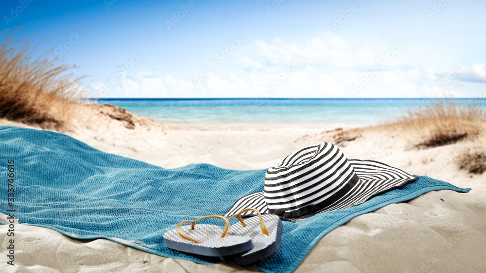 Fototapeta blue towel with hat and summer beach
