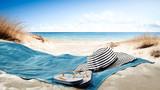 Fototapeta Fototapety z morzem do Twojej sypialni - blue towel with hat and summer beach