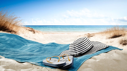blue towel with hat and summer beach