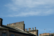 House Rooftops With Rows Of Ch...