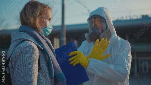 Controlling people\'s temperature at the entrance to airport railway station check woman the Covid-19 symptoms coronavirus checkpoints International airports mask infection epidemic corona slow motion
