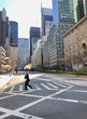 COVID-19 Effect to New Yorker's. Midtown Manhattan Park Avenue Business district where there are abnormally few people for impact of COVID-19 at New York City NY USA at 3:30 PM on Mar. 27 2020.