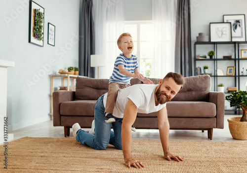 Obraz Father and little son having fun at home - fototapety do salonu