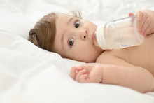 Cute Little Baby With Bottle O...