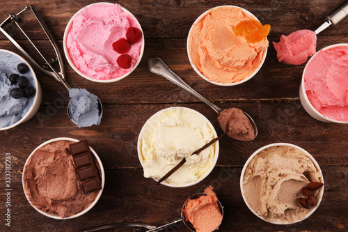 Fotografia, Obraz Various of ice cream flavor with fresh blueberry, strawberry, almond, chocolate, vanilla setup on rustic background