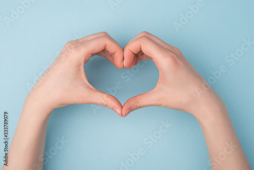 Fotografia Top pov above overhead close up view photo of hands making shape of heart isolat