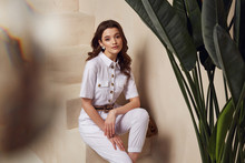 Portrait Of Beautiful Woman Fashion Model Brunette Hair Wear White Dress Suit Buttons Pocket Accessory Belt Jewelry Earrings Cosmetic Face Clothes For Date Party Walk Journey Summer Collection Stairs.