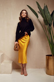 Fototapeta Na drzwi - Fashion model brunette hair wear yellow silk dress skirt black top sandals high heels accessory bag clothes for date party walk journey summer collection plant flowerpot wall stairs beautiful woman.