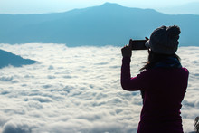 Silhouette Of Photographer On Top Mountain