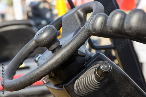 Valokuvatapetti Steering wheel and operating control panels or levers in forklift or other machi