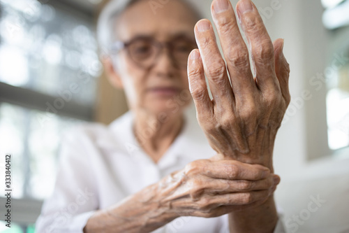 Elderly female patient suffer from numbing pain in hand,numbness fingertip,arthr Canvas Print