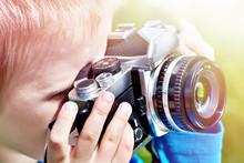Little Boy With Retro Camera