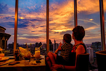 Skyline At Sunset From A Rooftop Bar In Bangkok, Thailand