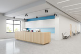 Reception and chairs in white blue hospital lobby
