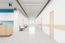 Hospital Corridor With Chairs And Reception