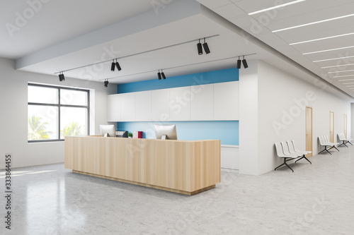 Reception and chairs in white blue hospital lobby Fototapet