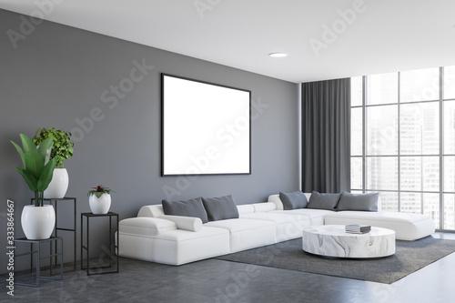 Fototapeta Gray living room corner with sofa and poster obraz