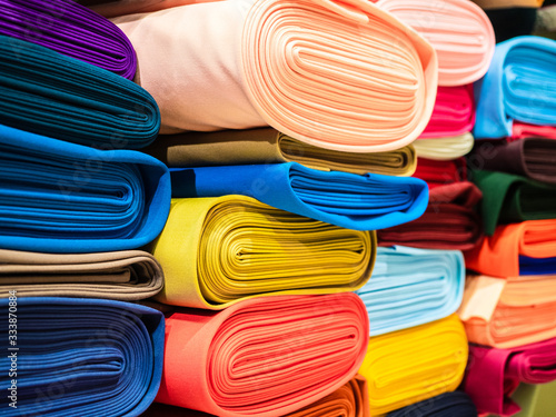 Fotografiet Rolls of bright multicolored fabric close-up