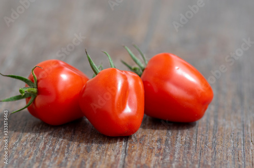 Fotografie, Tablou Solanum lycopersicum cultivated red ripened strawberry tomato, tasty fresh fruit