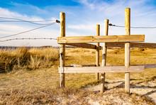 A Wooden Fence Or Gate Near A Meadow In Vejbystrand Sweden.
