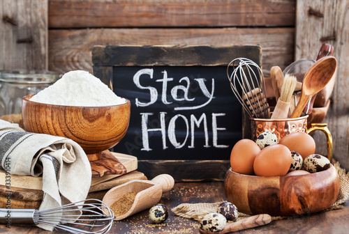 Obraz na plátně Baking ingredients and board with social notice stay at home