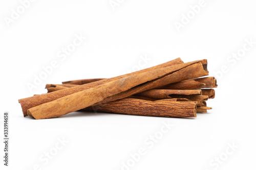 Fototapeta cinnamon sticks isolated on white