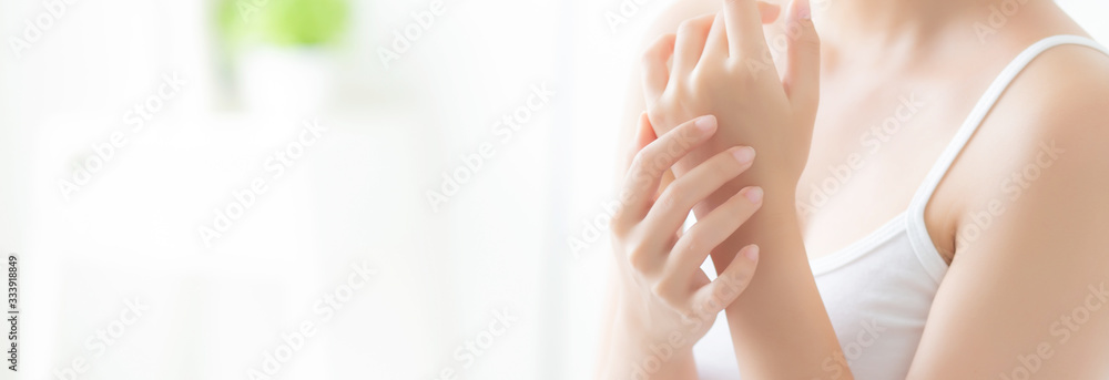 Fototapeta Beautiful closeup asian woman applying cream and treatment for skin care touch on hand, asia girl with lotion spa and moisturizing for health, lifestyle and beauty cosmetic concept, banner website.