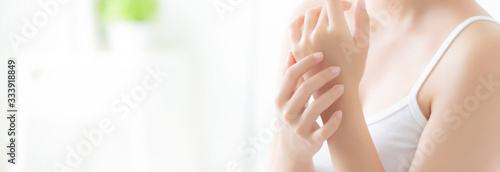 Obraz Beautiful closeup asian woman applying cream and treatment for skin care touch on hand, asia girl with lotion spa and moisturizing for health, lifestyle and beauty cosmetic concept, banner website. - fototapety do salonu