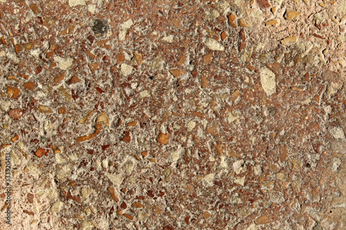 Fotografie, Obraz Reddish conglomerate rock grains texture on a rough surface