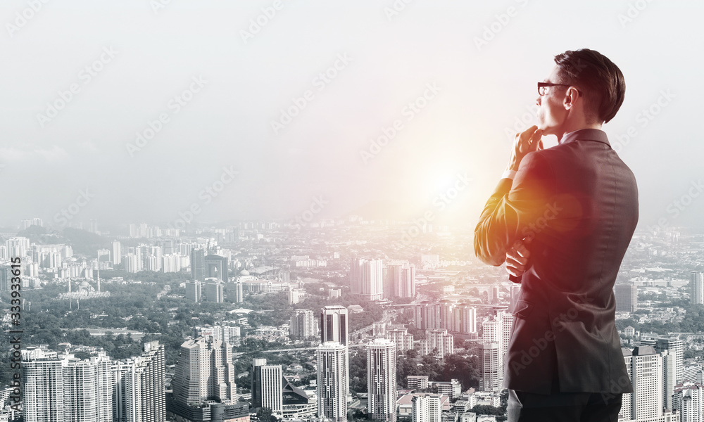 Fototapeta Concept of business success and control with confident boss against cityscape background