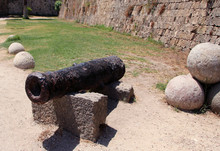 Old Rusty Medieval Cannon In T...