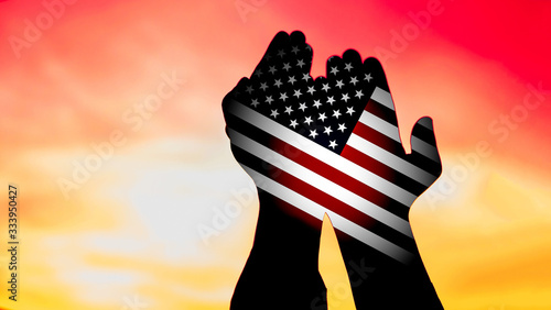 Photo double exposure image, american flag in praying hands for blessing, thank, forgi