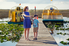 Young Mother With Her Little Son On An Airboat Tour. The Everglades Are A Natural Region Of Wetlands In The Southern Portion Of The U.S. State Of Florida, USA.