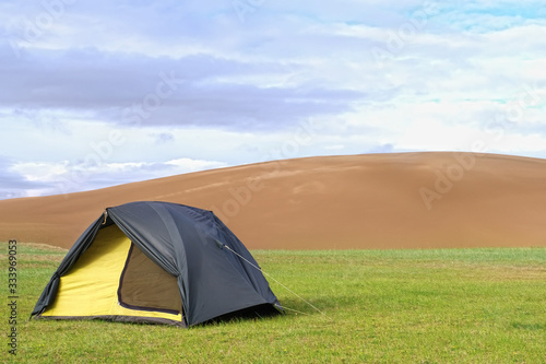 tent on a green lawn Canvas Print