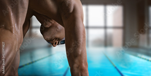 Fotografía Swimming pool. Muscular swimmer ready to jump.