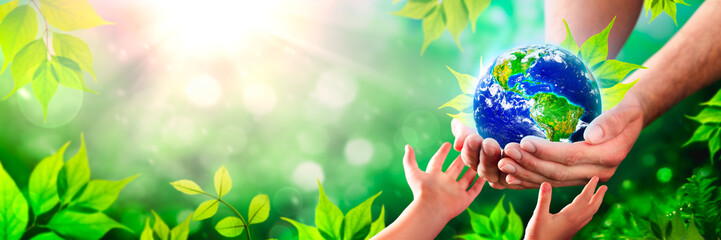 Hands Of Father Giving Earth With Leaves To Child - Protect The Environment For Future Generations Concept - Some Elements Of This Image Provided By NASA