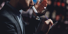 Winemaker Sommelier Smelling Red Wine Aroma In Glass