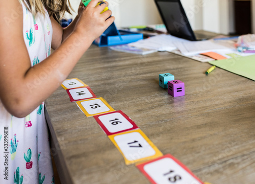 Vászonkép Faceless child playing homeschool math game with number line and dice