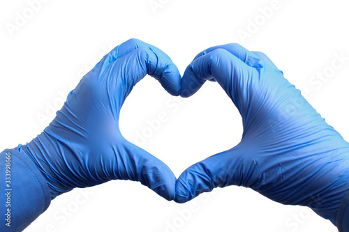 Fototapeta Hands in medical gloves depict a heart on a white background, isolated