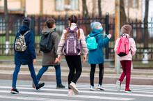 School Children Cross The Road...