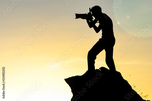 man who takes a picture of cliffs resembling human silhouette Wallpaper Mural