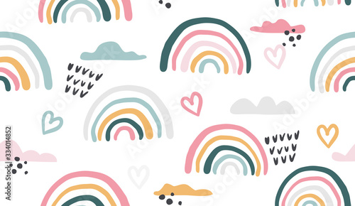 Seamless vector pattern with hand drawn rainbows