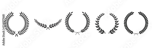Collection of different black and white silhouette circular laurel foliate  and oak, wreaths depicting an award, heraldry, achievement, victory, crown, winner, ornate,Vector  icon illustration Fototapet