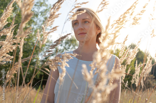 Portrait of a beautiful girl in the early morning in the field Canvas Print