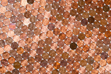 Full Frame Background Of American Pennies Of Varying Ages And Conditions Formed Into A Neat Pattern